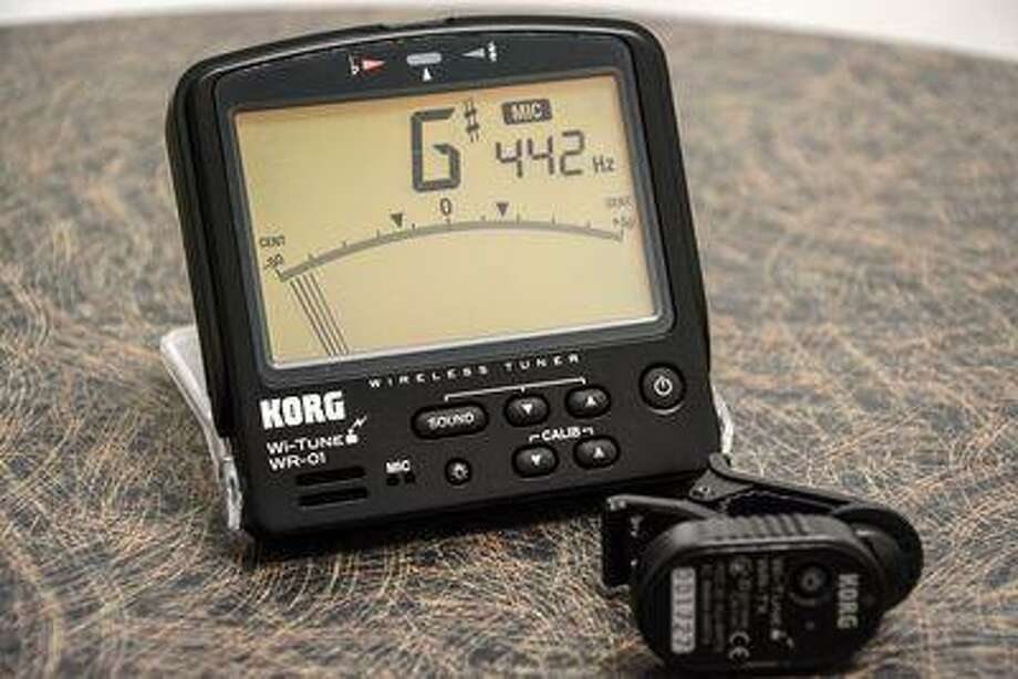 This Tuesday, May 28, 2013, photo, shows the Korg Wi-Tune wireless musical instrument tuner in Atlanta. (AP Photo/Ron Harris) Photo: AP / AP net