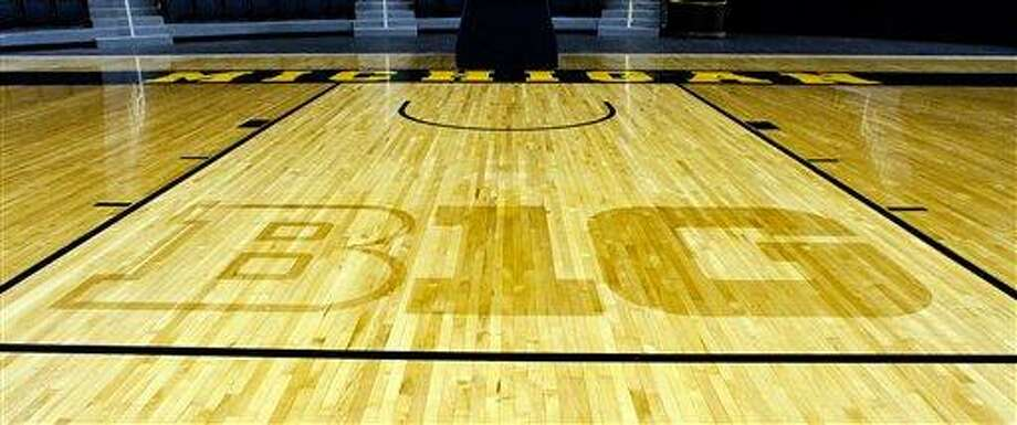 "The new Big Ten Conference logo ""B1G"" is stained into the wood of the Crisler Arena court in Ann Arbor, Mich. (AP Photo/Tony Ding) Photo: ASSOCIATED PRESS / AP2011"