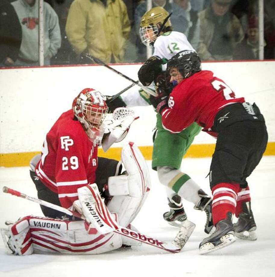 Fairfield Prep's goalie Matt Beck gets some help from Andrew Hatton during the third period of Prep's recent win over Notre Dame-West Haven. Center is Notre Dame's  Ryan Lynch. Melanie Stengel/Register.