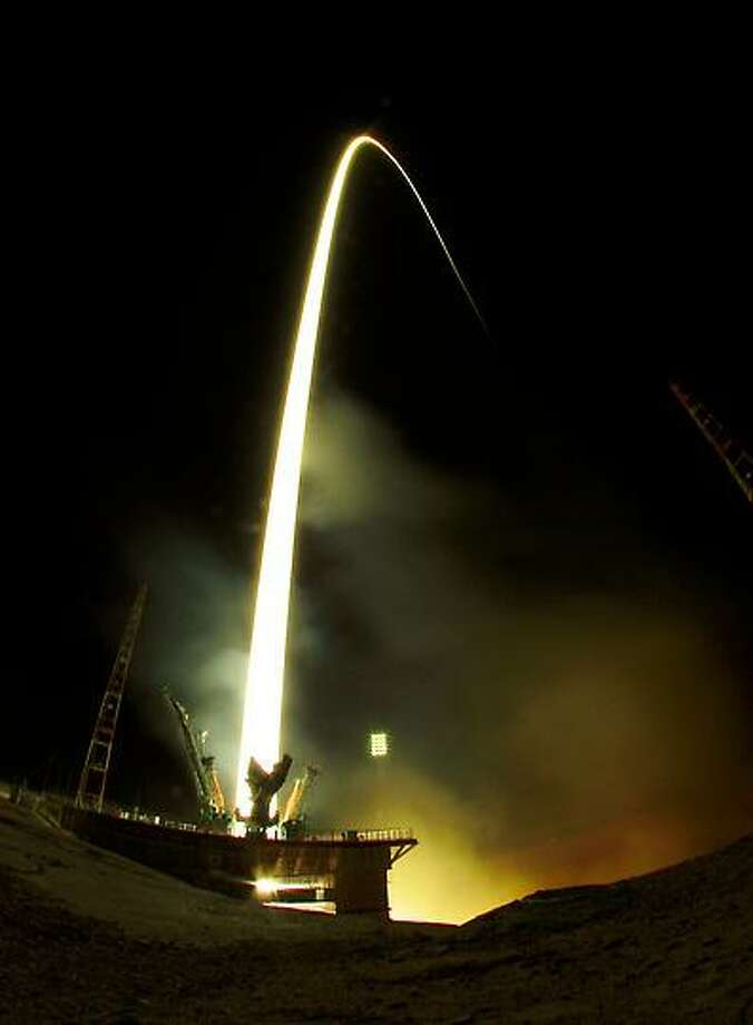 In this photo taken with a fisheye lens and with long time exposure the Soyuz-FG rocket booster with Soyuz TMA-08M space ship carrying a new crew to the International Space Station, ISS, blasts off at the Russian leased Baikonur cosmodrome, Kazakhstan, early Friday, March 29, 2013. The Russian rocket carries Russian Cosmonauts Alexander Misurkin and Pavel Vinogradov and U.S. astronaut Christopher Cassidy. (AP Photo/Dmitry Lovetsky) Photo: ASSOCIATED PRESS / AP2013