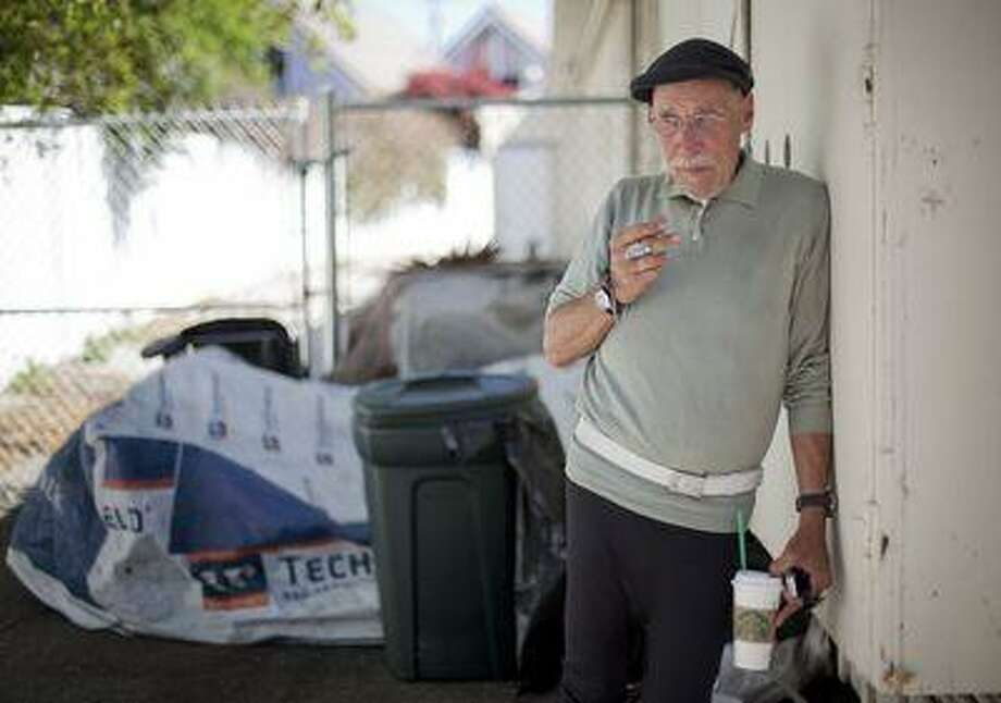 Former Olympic swimmer and Bronze-medalist Brian Job poses for a portrait in front of the small encampment where he lives behind a shopping center in Palo Alto, Calif. on Wednesday, April 10, 2013. Once a successful tech entrepreneur, Job developed bipolar disorder, fell prey to addiction and began living on the streets of Palo Alto. (LiPo Ching/Staff) Photo: San Jose Mercury News / San Jose Mercury News