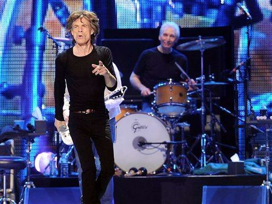 "This Dec. 15, 2012 file photo shows lead singer Mick Jagger, left, and Charlie Watts of The Rolling Stones during a performance at the Prudential Center in Newark, N.J. Before they kick off their ""50 and Counting"" tour, the Rolling Stones are playing a warm-up date in a small club in Los Angeles.  The band is due to play the Echoplex on Saturday night before a crowd that will be miniscule compared to the thousands who are set to see them perform May 3 at the Staples Center.  (Photo by Evan Agostini/Invision/AP) Photo: Evan Agostini/Invision/AP / Invision"