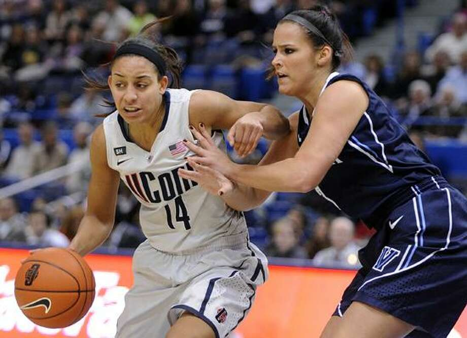 Connecticut's Bria Hartley, left, drives past Villanova's Jesse Carey during the first half of an NCAA college basketball game in Hartford, Conn., Tuesday, Jan. 29, 2013. (AP Photo/Fred Beckham) Photo: AP / AP2013