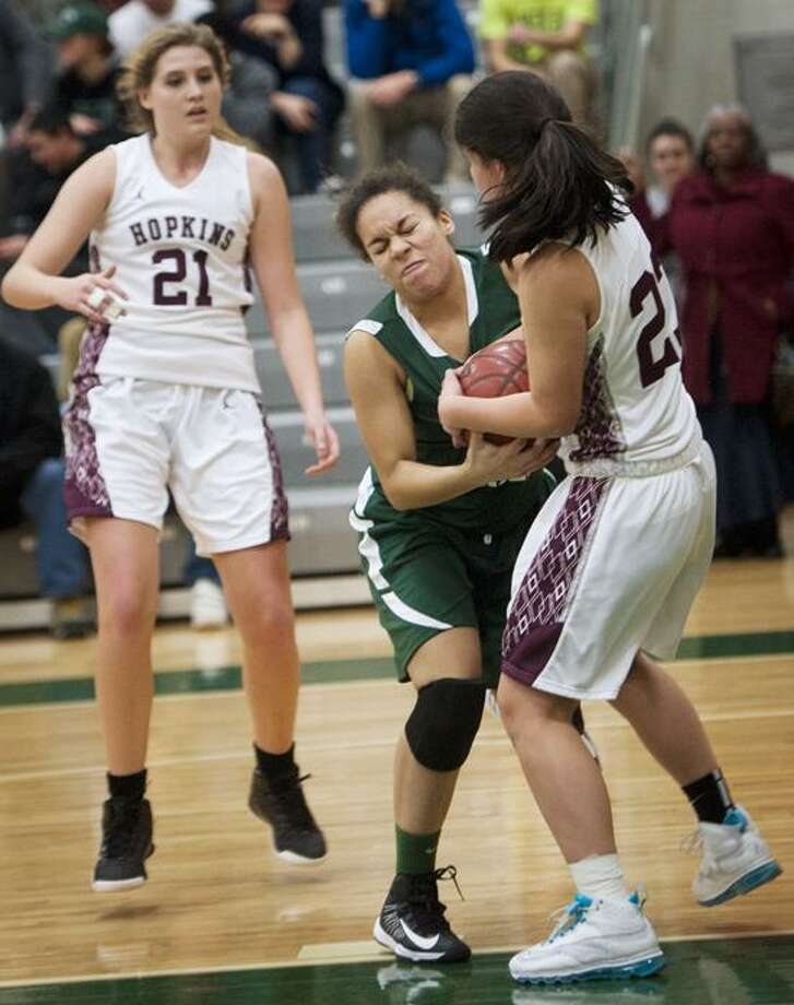 Hamden Hall's  Kayla Stanley and Hopkin's Claire Yin battle for the ball during Hamden Hall's win on Tuesday.  Melanie Stengel/Register