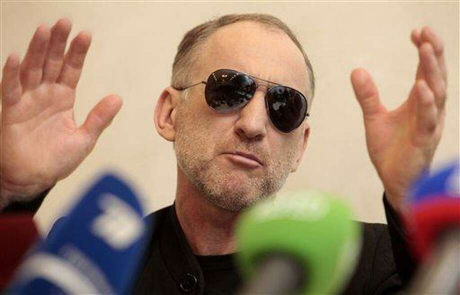 The father of the two Boston bombing suspects, Anzor Tsarnaev speaks at a news conference in Makhachkala, the southern Russian province of Dagestan, Thursday, April 25, 2013. The father of the two Boston bombing suspects said Thursday that he is leaving Russia for the United States in the next day or two, but their mother said she was still thinking it over. (AP Photo/Musa Sadulayev) Photo: AP / AP