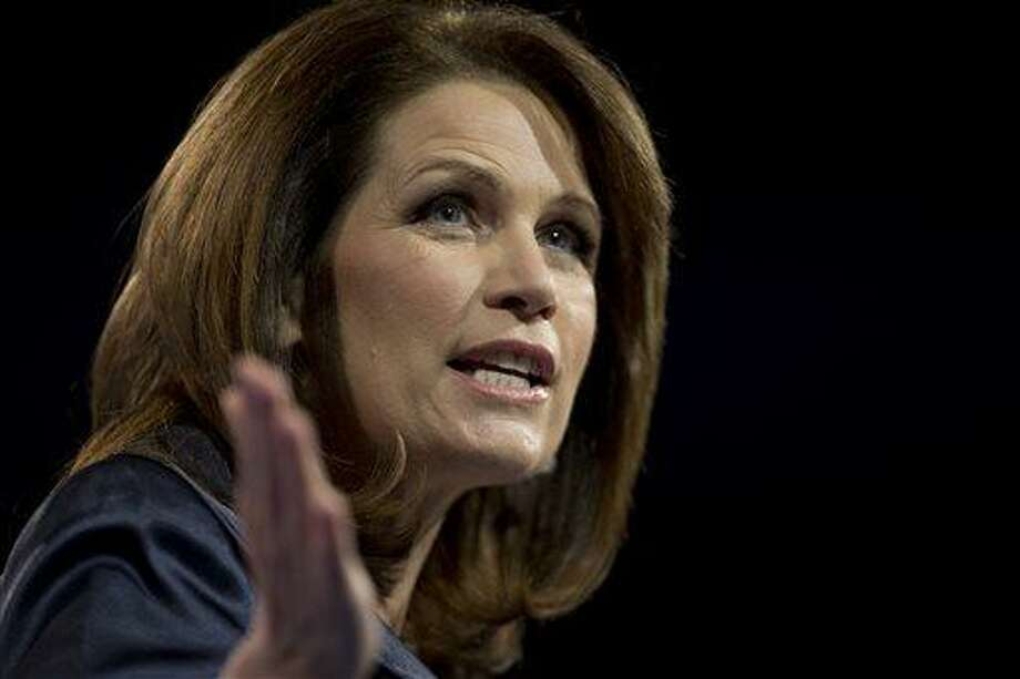 FILE - In this March 16, 2013 file photo, Rep. Michele Bachmann, R- Minn., speaks at the 40th annual Conservative Political Action Conference in National Harbor, Md. Bachmann said Wednesday, May 29, 2013, that she will not run for re-election in 2014. (AP Photo/Carolyn Kaster) Photo: AP / AP