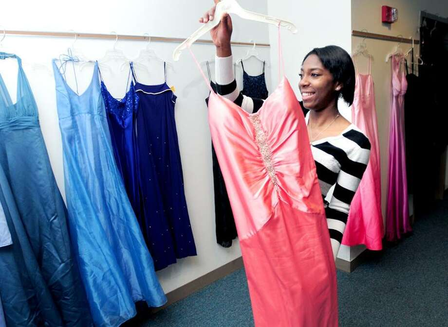 Hamden High School junior Stella Koughnigan, 17, shops for a prom gown from the Dream Girls program at the school on 3/28/2013.Photo by Arnold Gold/New Haven Register    AG0489E