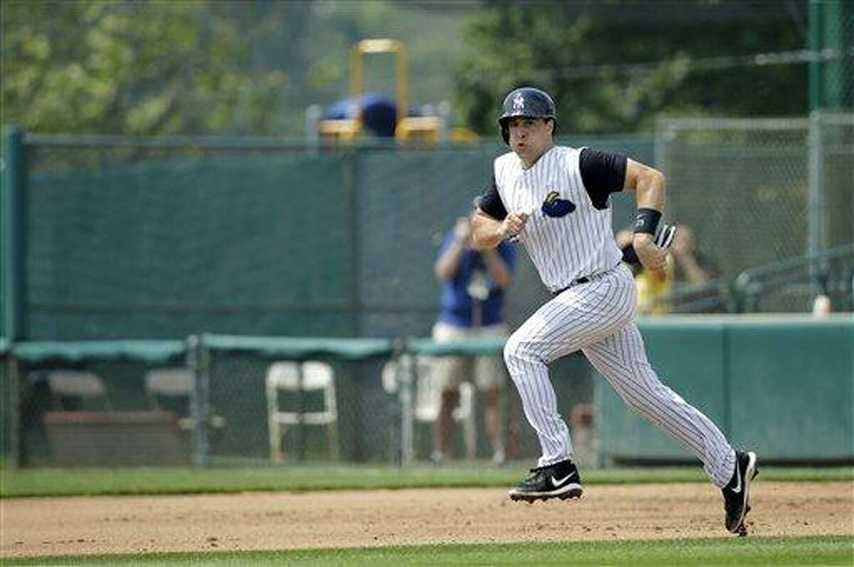 The New York Yankees first baseman Mark Teixeira runs toward second base during his rehab game in Trenton, N.J., Wednesday, May 29, 2013, with the Trenton Thunder, the Yankees Double-A affiliate against the Erie Seawolves. Teixeira is coming back from a wrist injury. (AP Photo/Mel Evans)