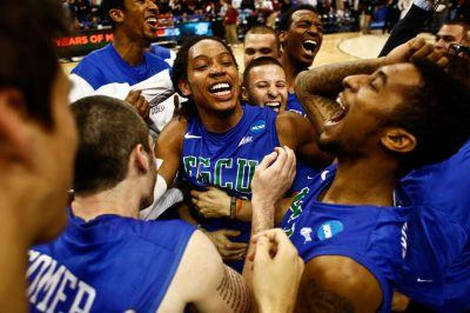 Florida Gulf Coast players celebrate after winning a third-round game against San Diego State in the NCAA college basketball tournament, Sunday, March 24, 2013, in Philadelphia. Florida Gulf Coast won 81-71. (AP Photo/Naples Daily News, Scott McIntyre) Photo: AP / Naples Daily News