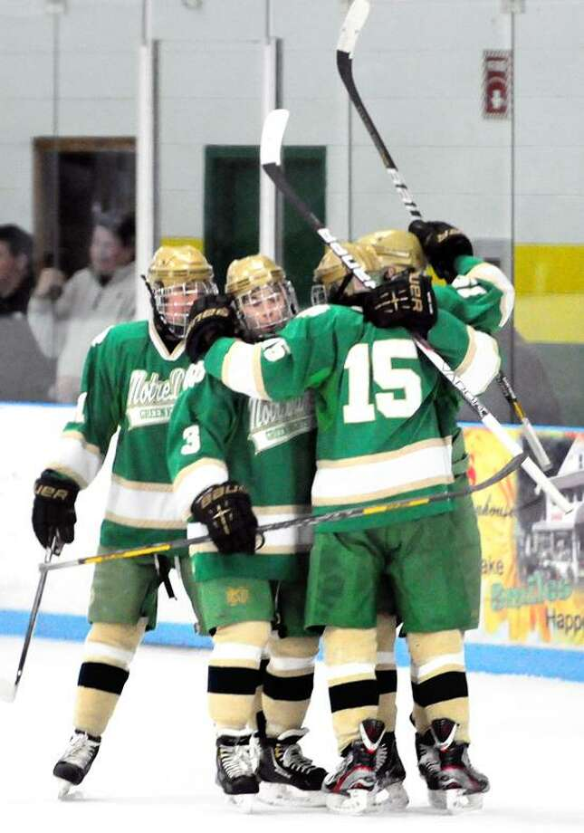 Notre Dame of West Haven celebrates a goal in the first period against Hamden on 1/26/2013.Photo by Arnold Gold/New Haven Register