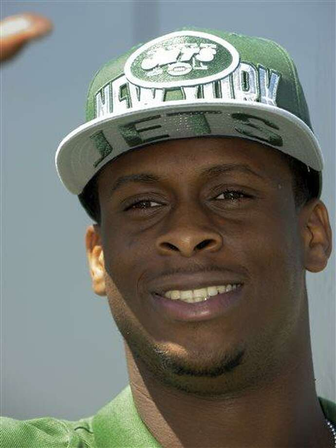 Quarterback Geno Smith, from West Virginia, speaks to reporters following a news conference after being selected Friday by the New York Jets with the seventh pick in the second round, 39th overall, in the NFL football draft, Saturday April 27, 2013 in Florham Park, N.J.  (AP Photo/Joe Epstein) Photo: AP / FR170243 AP