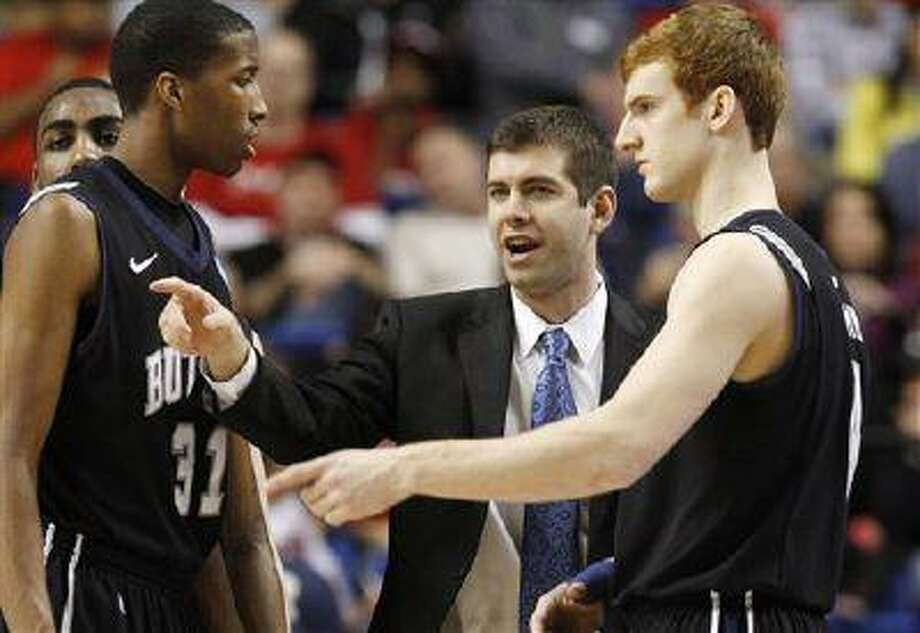 Butler head coach Brad Stevens talks with forwards Kameron Woods (31) and Erik Fromm (4) in the first half of a third-round NCAA Tournament game, March 23, 2013, in Lexington, Ky. Photo: AP / FRE6426 AP