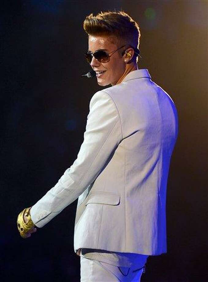 Justin Bieber performs on Tuesday, Jan. 22, 2013, in Charlotte, N.C. (AP Photo/The Charlotte Observer, Jeff Siner) Photo: AP / The Charlotte Observer