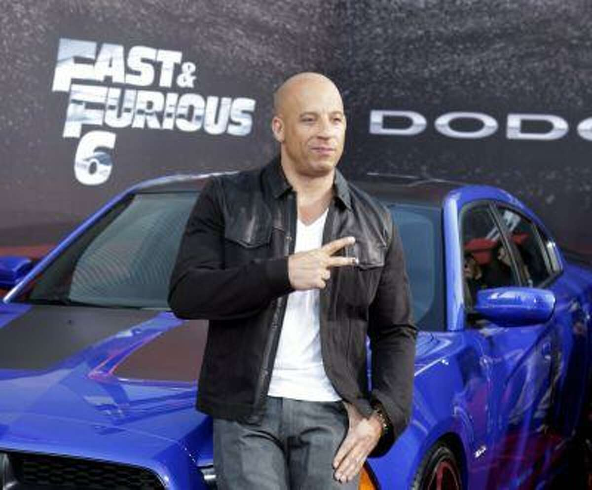 """Cast member and producer Vin Diesel poses at the premiere of the new film, """"Fast & Furious 6"""" at Universal Citywalk in Los Angeles May 21, 2013."""