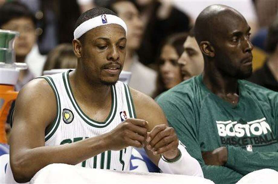 Boston Celtics' Paul Pierce, left, and Kevin Garnett sit on the bench during the fourth quarter of their 90-76 loss to the New York Knicks in Game 3 of a first round NBA basketball playoff series in Boston Friday, April 26, 2013. (AP Photo/Winslow Townson) Photo: AP / FR170221 AP