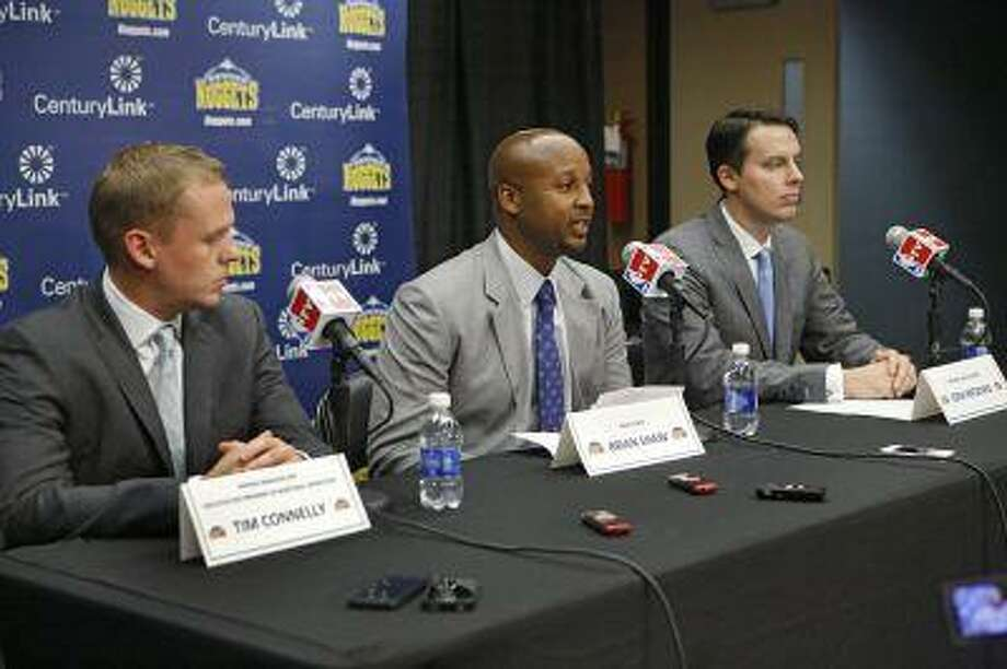 Denver Nuggets new head coach Brian Shaw, center, is flanked by general manager Tim Connelly, left, and team president Josh Kroenke during an NBA basketball news conference where Shaw was introduced as the new head coach in Denver on Tuesday, June 25, 2013. Photo: AP / AP