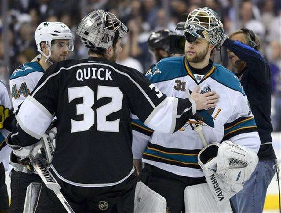 Los Angeles Kings goalie Jonathan Quick, left, greets San Jose Sharks goalie Antti Niemi, of Finland, after the Kings 2-1 win in Game 7 of the Western Conference semifinals in the NHL hockey Stanley Cup playoffs, Tuesday, May 28, 2013, in Los Angeles.  (AP Photo/Mark J. Terrill) Photo: AP / AP