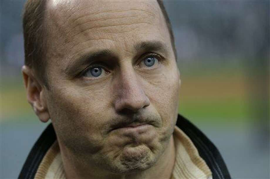 FILE - In this Oct. 17, 2012 file photo, New York Yankees general manager Brian Cashman listens to a question from the media before Game 4 of the American League championship series against the Detroit Tigers, in Detroit. The mother of a woman accused of stalking Cashman has abruptly dropped her lawsuit against him. The New York Post reports that Caroline Meanwell filed documents in court Tuesday, March 26, 2013,+ to drop the lawsuit. (AP Photo/Paul Sancya, File ) Photo: AP / AP