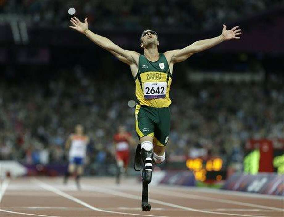 FILE - In this Sept. 8, 2012 file photo, South Africa's Oscar Pistorius wins gold in the men's 400-meter T44 final at the 2012 Paralympics in London. A judge in South Africa says Pistorius, who is charged with murdering his girlfriend, can leave South Africa to compete in international competition, with conditions. (AP Photo/Kirsty Wigglesworth, File) Photo: AP / AP