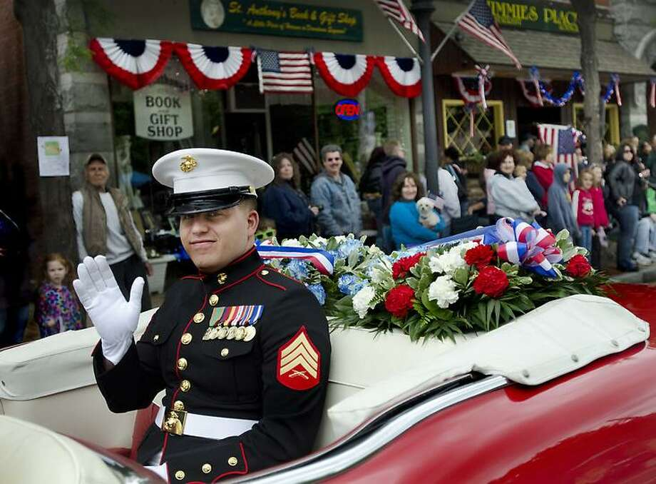 Seymour-Grand Marshal of Seymour Parade waves to crowd.   Melanie Stengel/Register