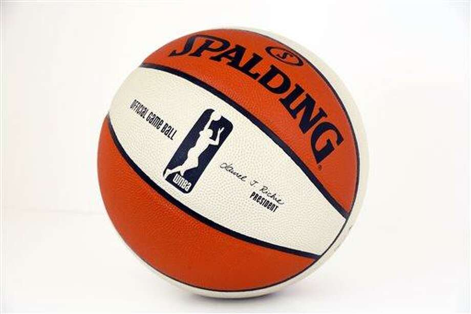 This undated photo provided by NBA Entertainment/Getty Images shows an official game basketball bearing a rebranded WNBA logo that features a silhouette of a player in the act of shooting a layup. Previously, the silhouette was of a player dribbling, similar to the logo used by the NBA. In addition to the revamped logo, the league and network announced Thursday, March 28, 2013, they had extended their contract with ESPN through the 2022 season. (AP Photo/NBA Entertainment/Getty Images, Jesse D. Garrabrant) Photo: AP / NBA Entertainment/Getty Images