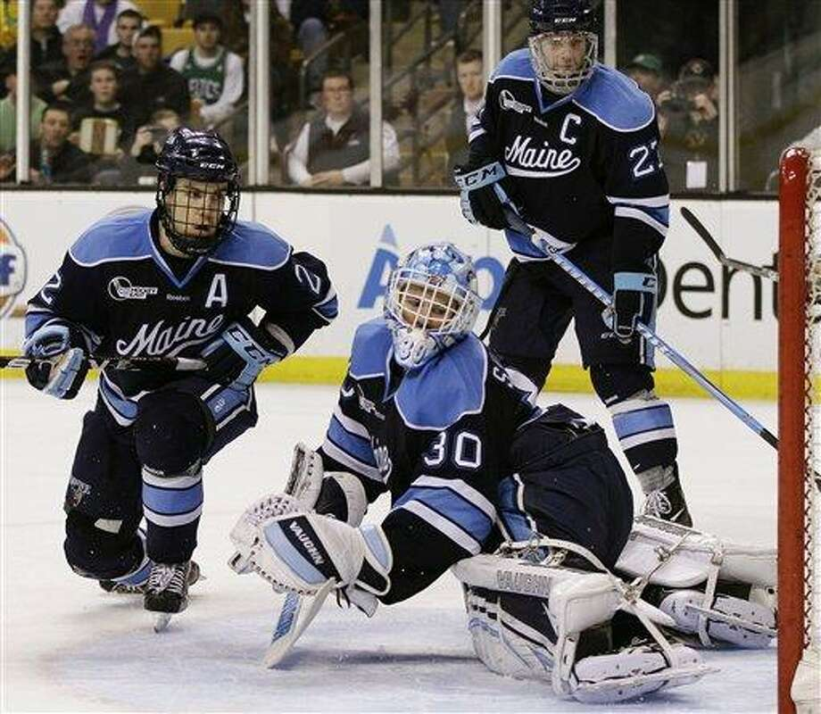 Maine goaltender Dan Sullivan (30), Stu Higgins (22) and Will O'Neill (27) react as the puck goes in the net for a goal by Boston College's Pat Mullane in the second period of an NCAA college Hockey East final in Boston, Saturday, March 17, 2012. (AP Photo/Elise Amendola) Photo: ASSOCIATED PRESS / AP2012