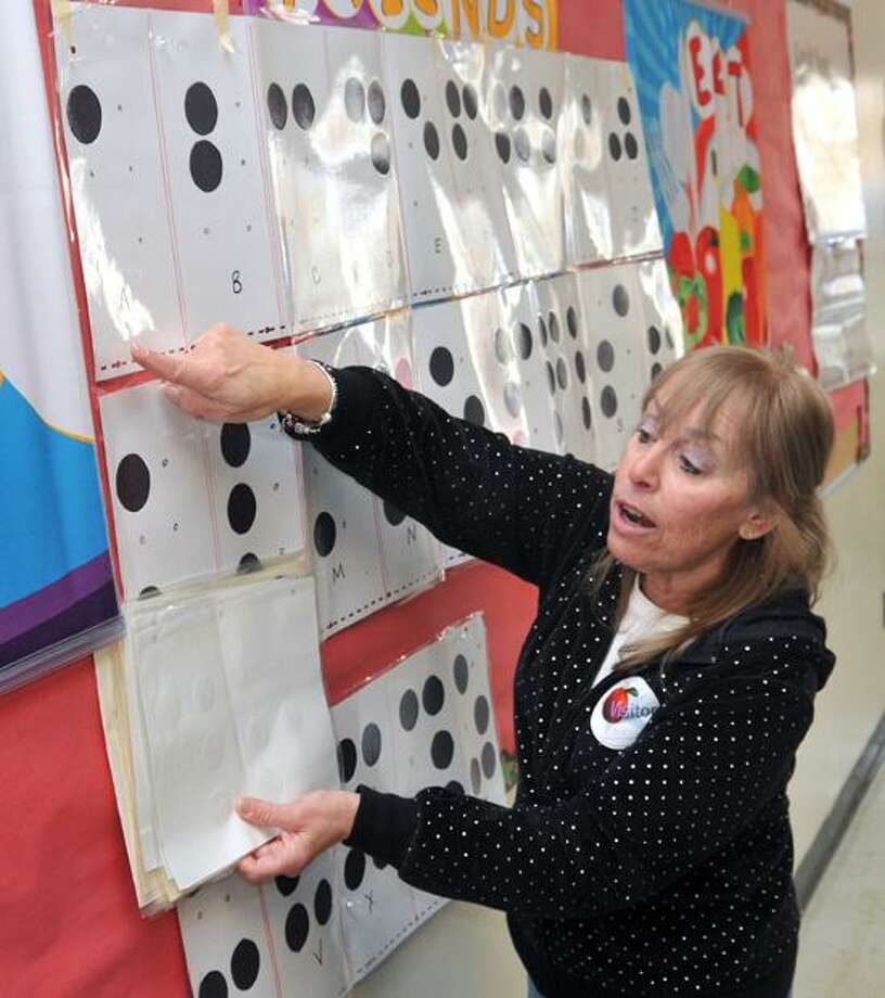 Derby-- Ellen Bedford, a retired teacher from Seymour, shows 3rd graders at Bradford Elementary school the Braille code. Bedford was teaching the children about Braille, a tactile writing system used by the blind and the visually impaired.  Photo-Peter Casolino 1/23/13