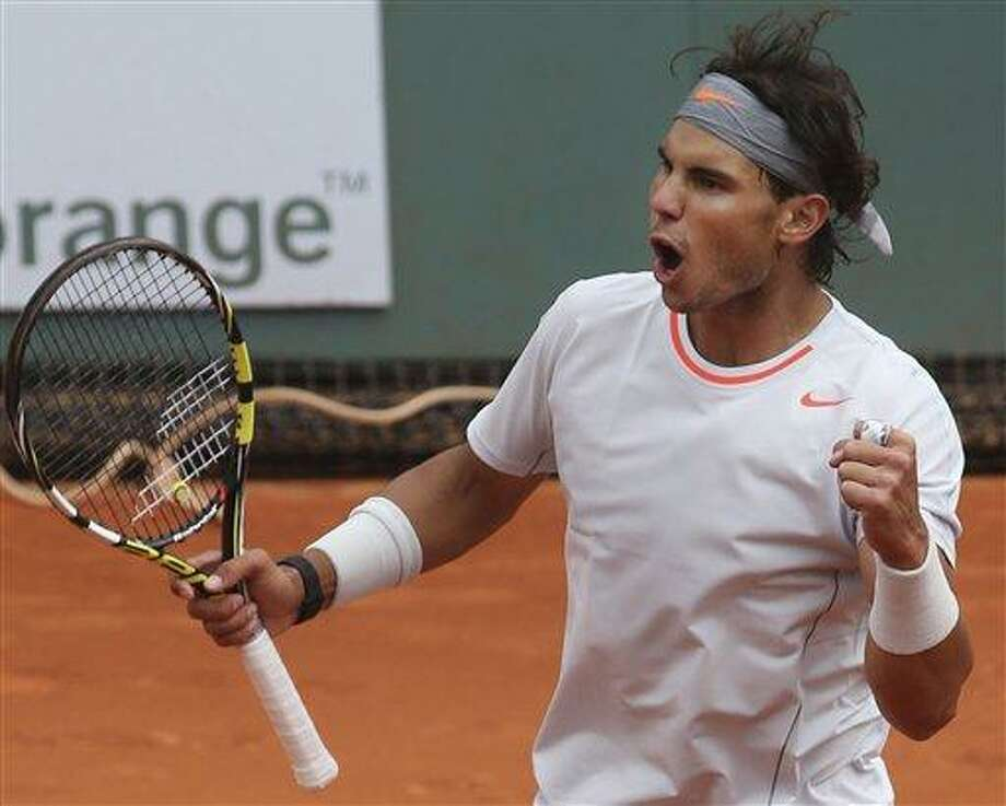 Spain's Rafael Nadal celebrates defeating Germany's Daniel Brands in their first round match of the French Open tennis tournament, at Roland Garros stadium in Paris, Monday, May 27, 2013. Nadal won in four sets 4-6, 7-6, 6-4, 6-3. (AP Photo/Michel Euler) Photo: AP / AP