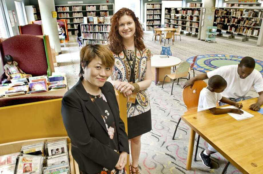 NEW HAVEN-City Librarians, Xia Feng (L) and Marie Jarry in the children's section of the  New Haven Free Public Library's Main Branch.   Melanie Stengel/Register