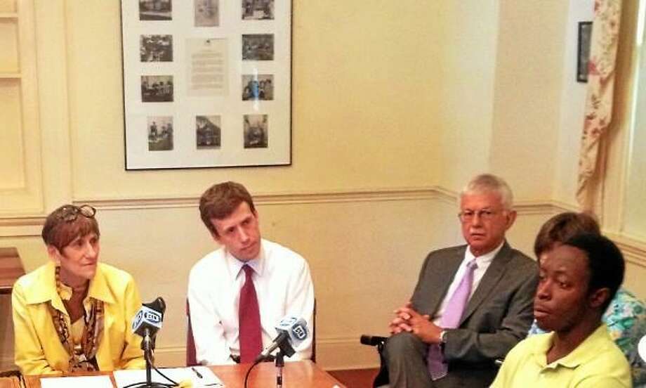Alex Gecan/The Middletown Press Central Connecticut University Student Russhane Bowerise (far right) addresses Congresswoman Rosa DeLauro (far left) at a roundtable discussion on student loan interest rates at the DeKoven House Community Center Monday.