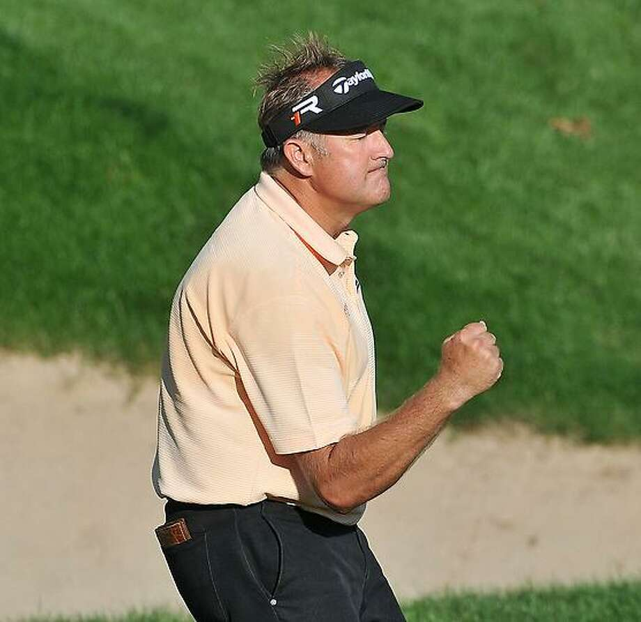 """Peter Casolino -- June 23, 2013- Ken Duke pumps his fist as he sinks his final putt to win the 2013 Travelers Championship. <a href=""""mailto:pcasolino@newhavenregister.com"""">pcasolino@newhavenregister.com</a>"""