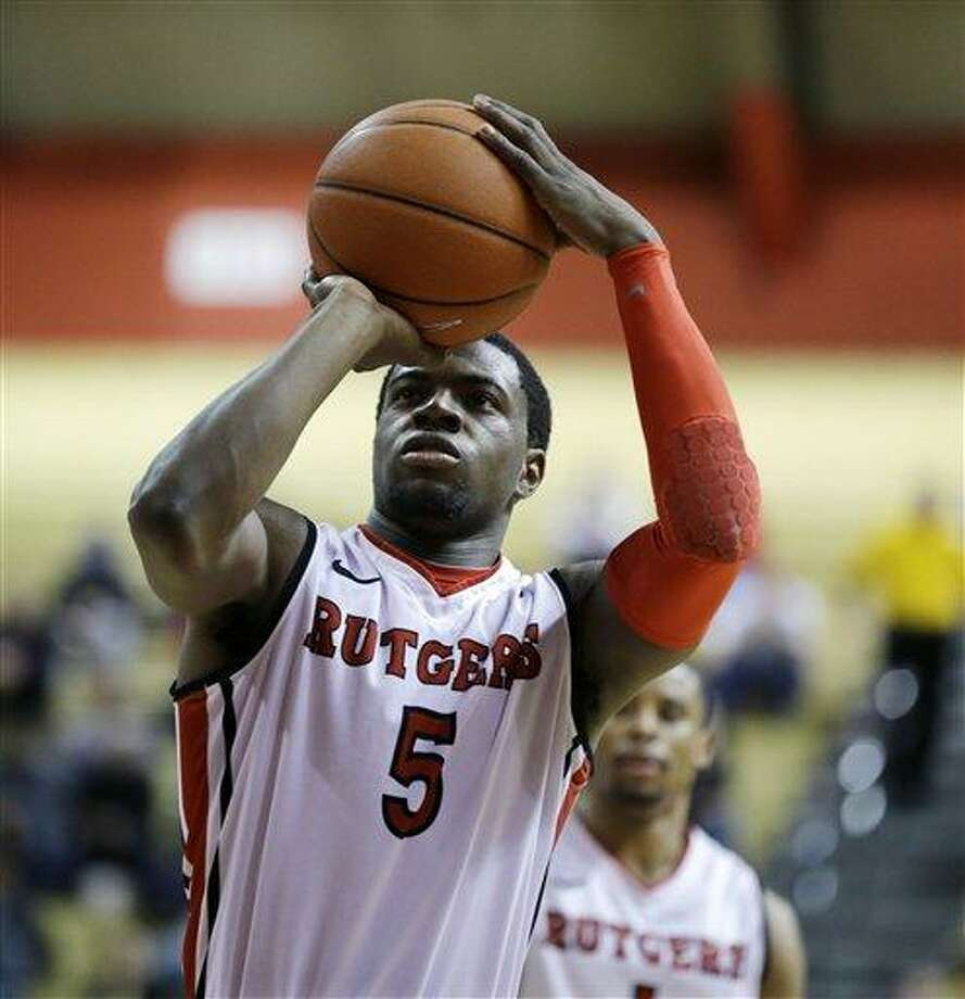 Rutgers' Eli Carter (5) takes a shot in the second half of the NCAA college basketball game against Pittsburgh Saturday, Jan. 5, 2013, in Piscataway, N.J. (AP Photo/Mel Evans) Photo: ASSOCIATED PRESS / AP2013
