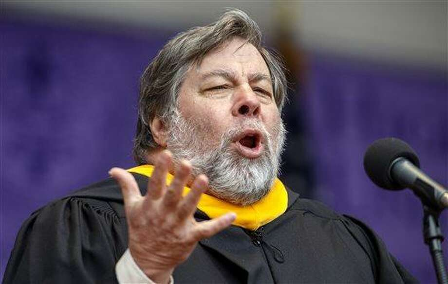 Apple co-founder Steve Wozniak speaks during the commencement of more than 900 students at High Point University's graduation ceremony on Saturday, May 4, 2013, in High Point, N.C. (AP Photo/News & Record, Jerry Wolford) Photo: AP / News & Record