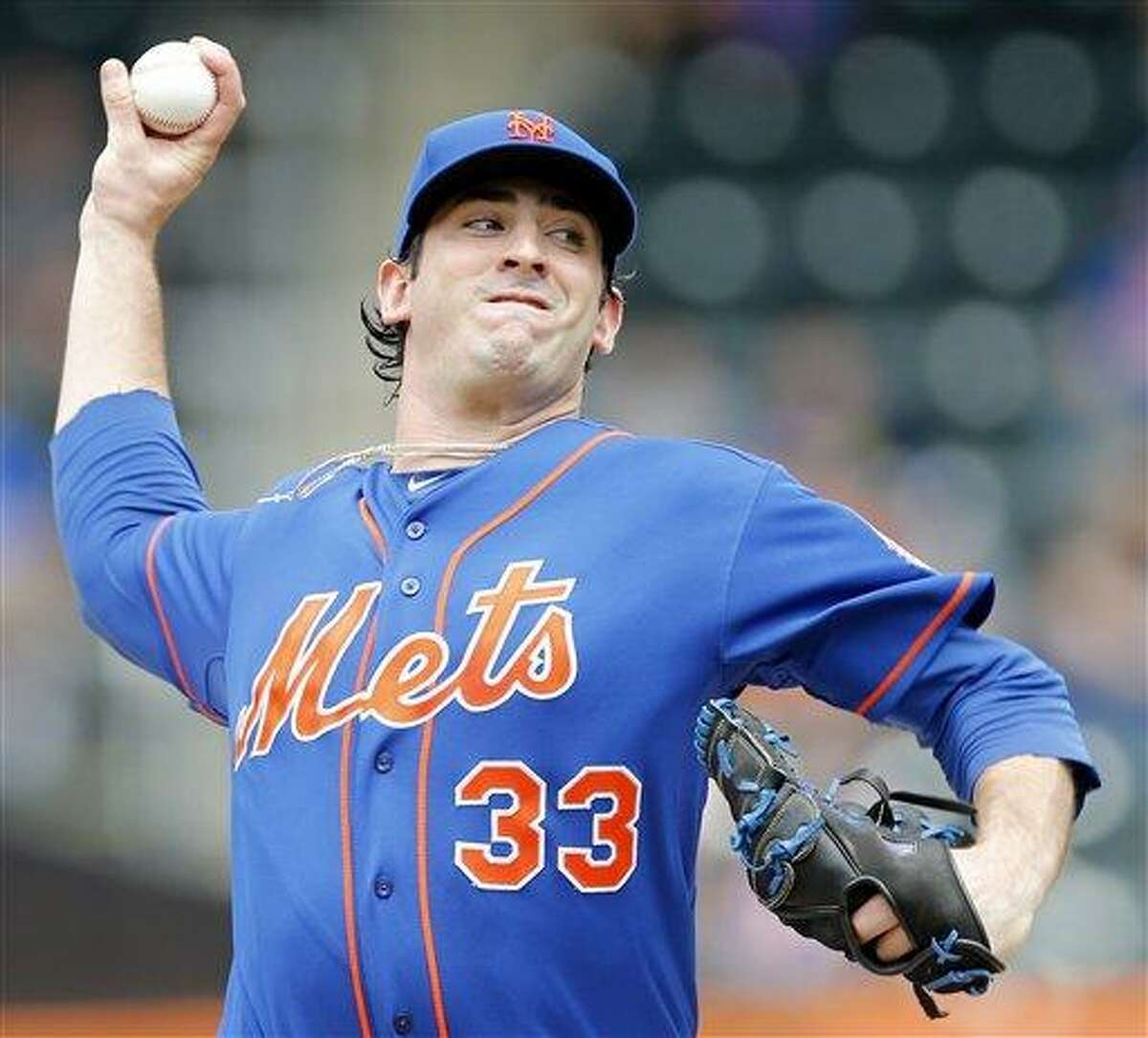 New York Mets starting pitcher Matt Harvey (33) throws a pitch in the second inning of a baseball game against the Miami Marlins at Citi Field in New York, Saturday, June 8, 2013. (AP Photo/Paul J. Bereswill)