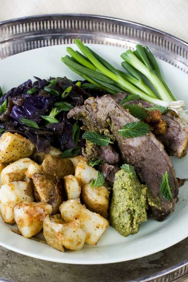 Matthew Mead/Associated Press photo: Orange and Mint-Stuffed Lamb With Sweet-and-Sour Cabbage Photo: AP / AP2013