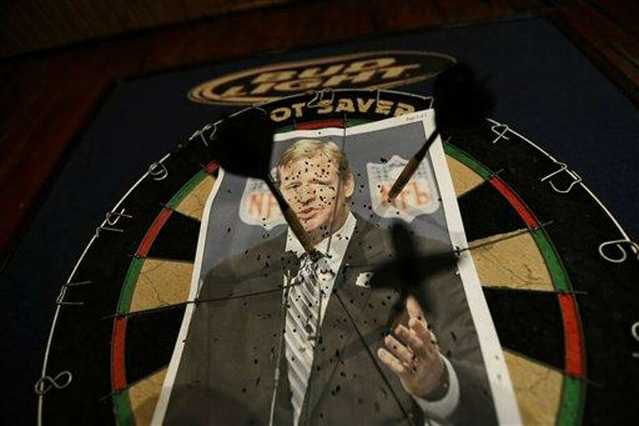 """A photo of NFL commissioner Roger Goodell is seen on a dartboard inside the Parkview Tavern in New Orleans, Friday, Jan. 25, 2013. New Orleans is celebrating the return of New Orleans Saints coach Sean Payton after a season's NFL banishment as a result of the """"Bountygate"""" scandal. But the good feeling does not extend to Goodell, who suspended Payton and other key players and coaches last year in the alleged pay-for-pain scheme. He is being ridiculed here with a vehemence usually reserved for the city's multitude of scandal-scarred politicians. (AP Photo/Gerald Herbert) Photo: ASSOCIATED PRESS / AP2013"""