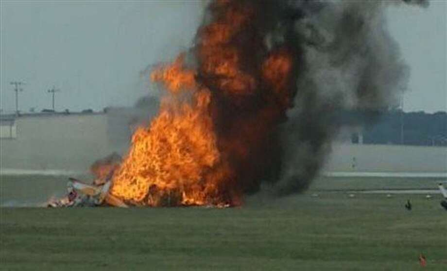 This photo provided provided WHIO TV shows a plane after it crashed Saturday, June 22, 2013, at the Vectren Air Show near Dayton, Ohio. There was no immediate word on the fate of the pilot, wing walker or anyone else aboard the plane. No one on the ground was hurt. (AP Photo/WHIO-TV) Photo: AP / WHIO TV