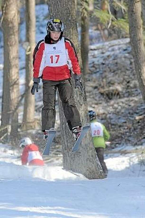 Laurie Gaboardi/Register Citizen Daniel Buonono takes to the air in the annual Alpine Ski Jumping competition at Satre Hill in Salisbury, Saturday.