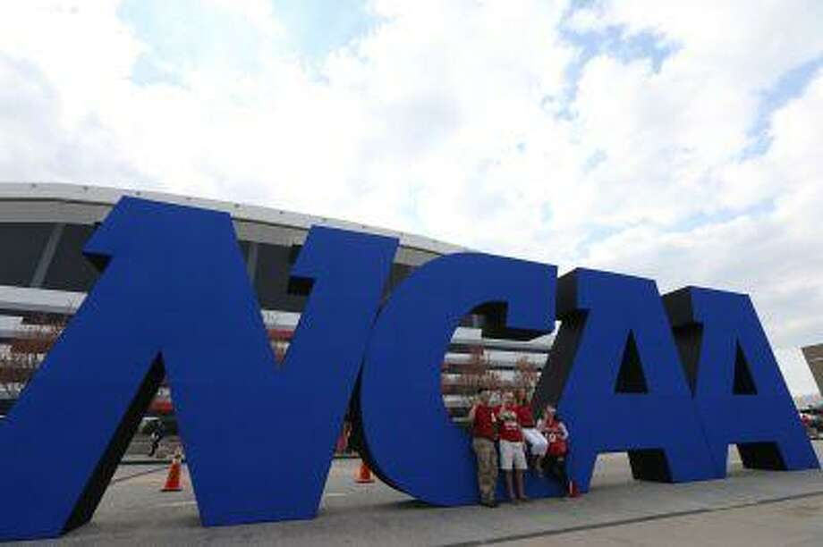 Apr 8, 2013; Atlanta, GA, USA; Fans take photos in front of a giant NCAA logo before the championship game in the 2013 NCAA Men's Final Four at the Georgia Dome. Photo: USA TODAY Sports / Daniel Shirey