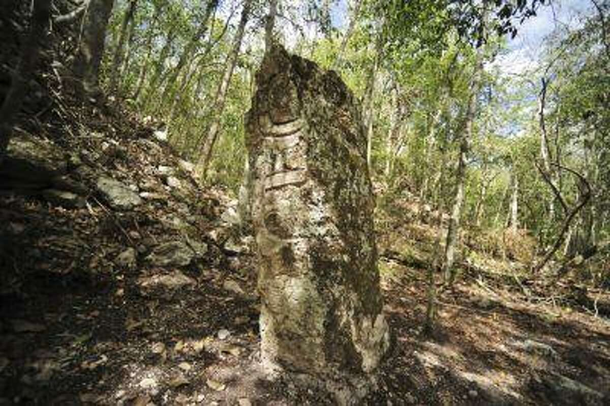 A sculpted stone shaft called stelae is pictured at the newly discovered ancient Maya city Chactun in Yucatan peninsula in this May 31, 2013 handout picture by National Institute of Anthropology and History (INAH) made available to Reuters June 18, 2013. Archaeologists have found the ancient Maya city that remained hidden for centuries in the rain forests of eastern Mexico, a discovery in a remote nature reserve they hope will yield clues about how the civilization collapsed around 1,000 years ago. REUTERS/INAH/Handout via Reuters (MEXICO - Tags: ENVIRONMENT SOCIETY TRAVEL) ATTENTION EDITORS - THIS IMAGE WAS PROVIDED BY A THIRD PARTY. FOR EDITORIAL USE ONLY. NOT FOR SALE FOR MARKETING OR ADVERTISING CAMPAIGNS. THIS PICTURE IS DISTRIBUTED EXACTLY AS RECEIVED BY REUTERS, AS A SERVICE TO CLIENTS