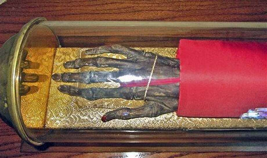 AP MEMBER FEATURE EXCHANGE ADVANCE FOR MAY 15 - In this May 10, 2013 photo, the hand of St. Edmund of Canterbury rests on a pillow in a glass case on Enders Island, in Stonington, Conn. The arm was severed from St. Edmund's body centuries before it came into the possession of the Catholic society that now displays it. (AP Photo/Journal Inquirer, Tom Breen)  MANDATORY CREDIT Photo: AP / Journal Inquirer
