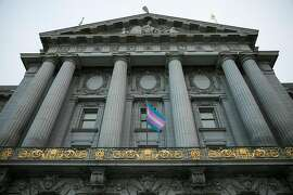 The transgender flag is seen in front of San Francisco's City Hall.