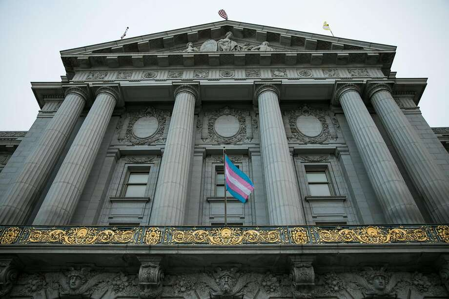 The transgender flag is seen in front of San Francisco's City Hall. Photo: Mason Trinca, Special To The Chronicle