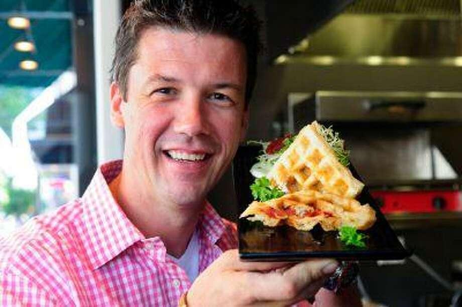Chef Bart Vandaele with his Smoked Salmon Waffles With Wasabi Yogurt. It takes hardly any time to put together. (Washington Post/Maddie Meyer)