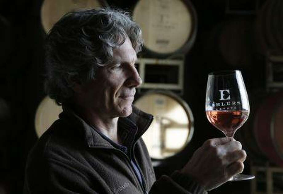 In this photo taken Monday, Jan. 7, 2013 winemaker Kevin Morrisey looks over a sample of Rose from a barrel at Ehler's Estate in St. Helena, Calif. Proceeds from the winery's sales go to the Leducq Foundation which continues to award over $30 million annually to directly support international cardiovascular research. (AP Photo/Eric Risberg) Photo: ASSOCIATED PRESS / AP2013