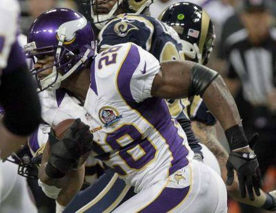 Minnesota Vikings running back Adrian Peterson (28) breaks free for an 82-yard touchdown run during the second quarter of an NFL football game against the St. Louis Rams Sunday, Dec. 16, 2012, in St. Louis. Photo: ASSOCIATED PRESS / AP2012