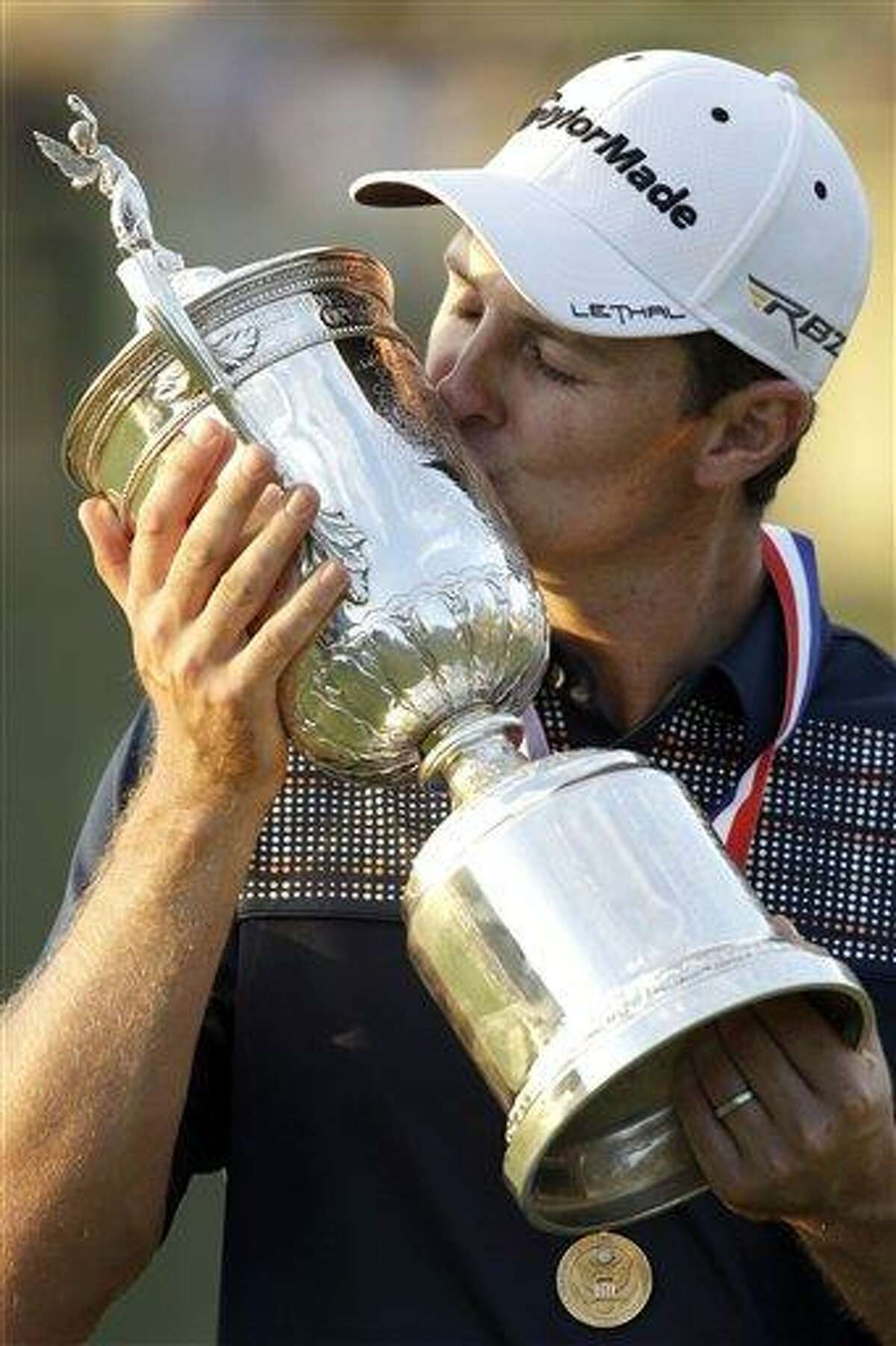 Justin Rose, of England, poses with the trophy after winning the U.S. Open golf tournament at Merion Golf Club, Sunday, June 16, 2013, in Ardmore, Pa. (AP Photo/Morry Gash)