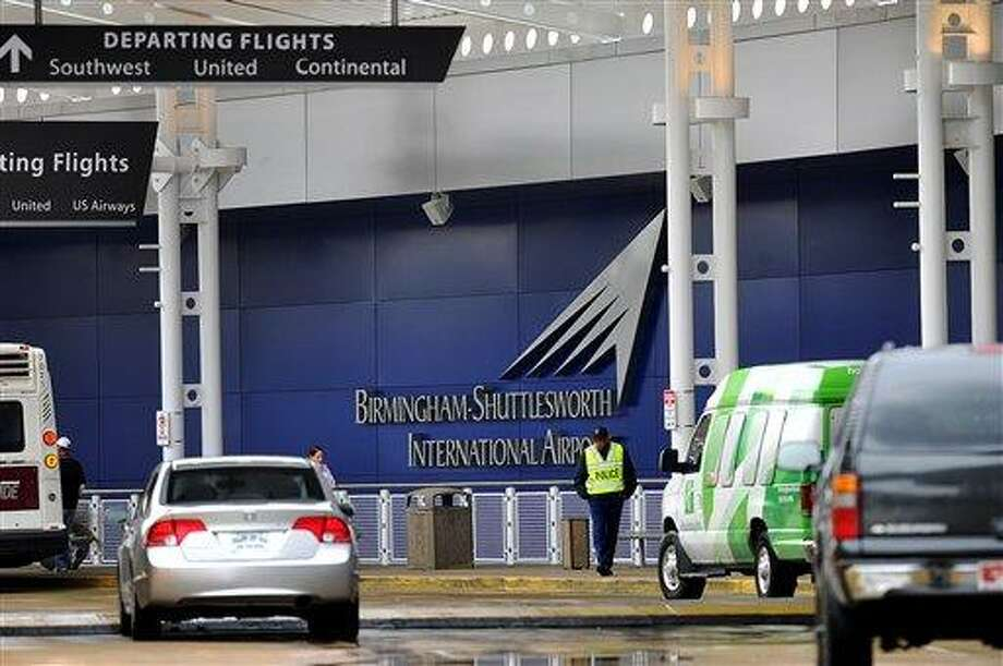 """A flight information sign at the newly renovated Birmingham-Shuttlesworth International Airport in Birmingham, Ala., fell on a mother and her three children Friday afternoon, March 22, 2013, killing one child and injuring the mother and her two other children. (AP Photo/Tamika Moore, <a href=""""http://AL.com"""">AL.com</a>) Photo: AP / AL.com"""