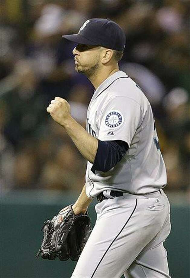 Seattle Mariners' Oliver Perez celebrates at the end of a baseball game against the Oakland Athletics Friday, June 14, 2013, in Oakland, Calif. (AP Photo/Ben Margot) Photo: AP / AP