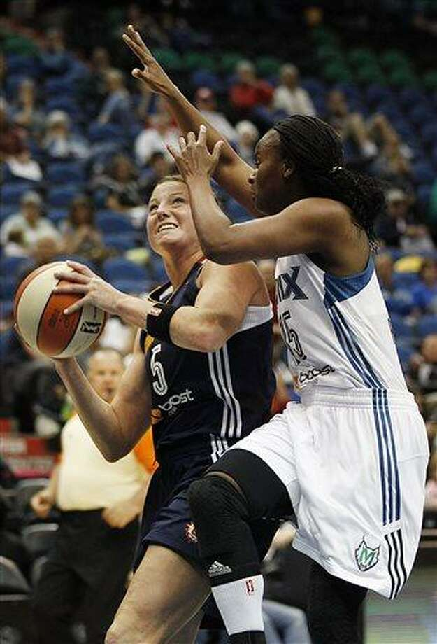 Connecticut Sun forward Kelsey Griffin (5) looks to shoot against Minnesota Lynx guard Ta'Shauna Rodgers (15) in the second half of a WNBA preseason women's basketball game, Tuesday, May 21, 2013, in Minneapolis. The Sun won 80-88. (AP Photo/Stacy Bengs) Photo: AP / FR170489 AP